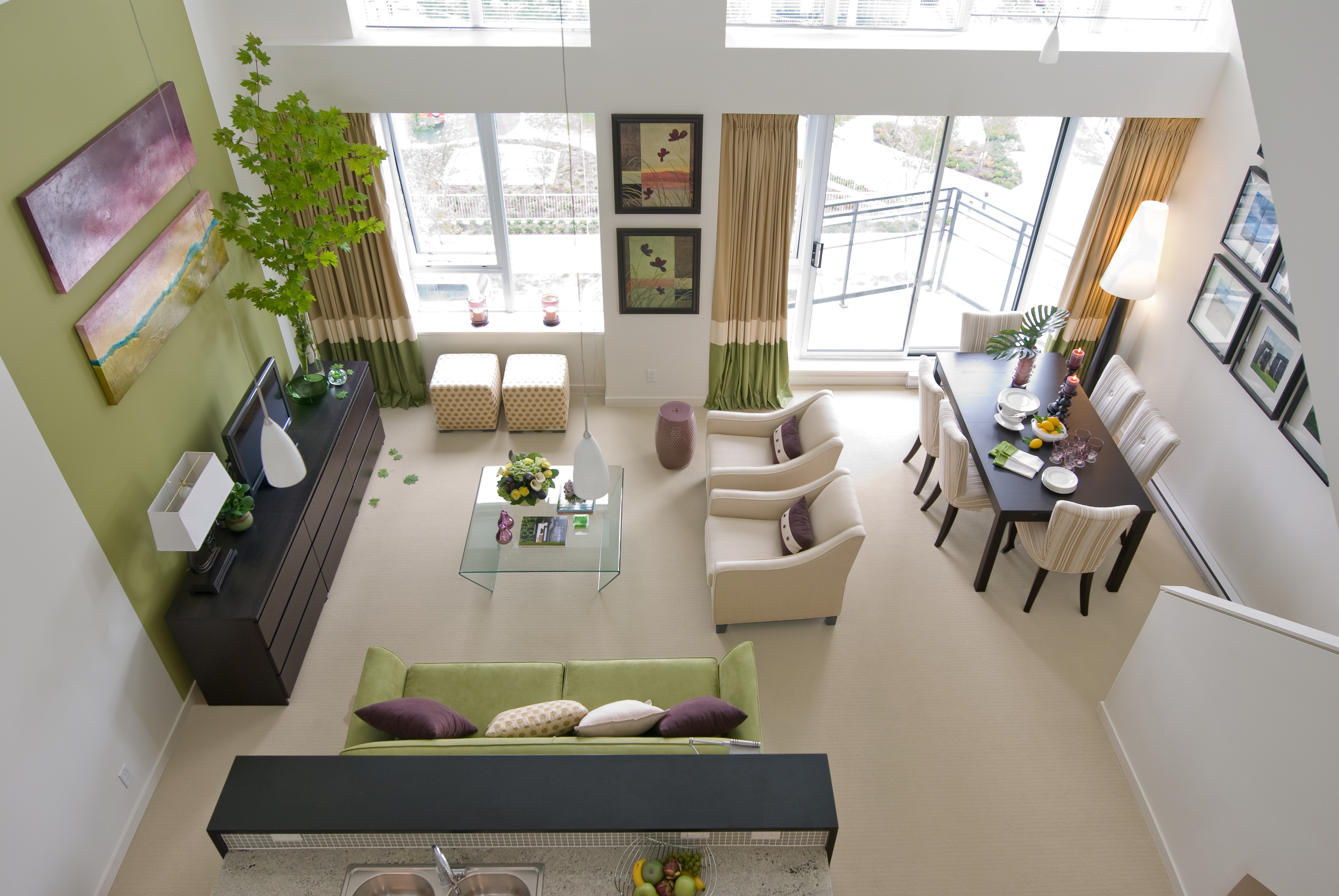 Living room with large windows and one wall painted green