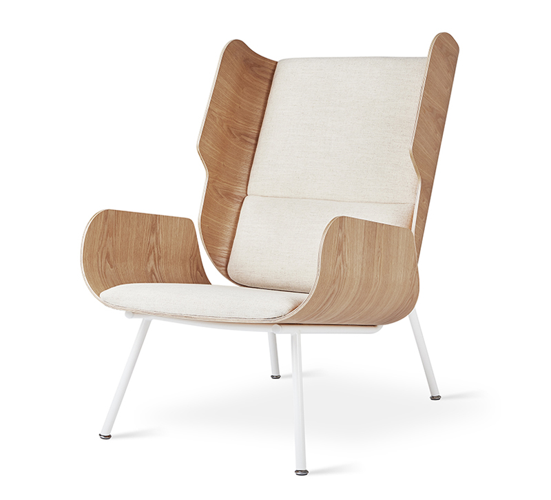 Elk chair with rounded wooden sides, white cushions on the seat and back and white, skinny legs from Gus Modern