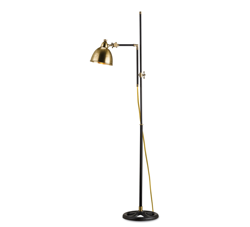 Drayton floor lamp with a black base and brass accents and shade from Currey & Co.