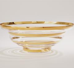 Saturn Bowl with lines of gold alternating with clear glass from Global Views